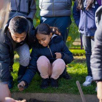 Hague primary residential oct 19 helmingham hall - children touching soil